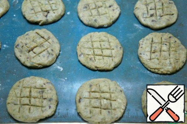 Place on a baking sheet covered with parchment or silicone Mat. Make notches with a knife.