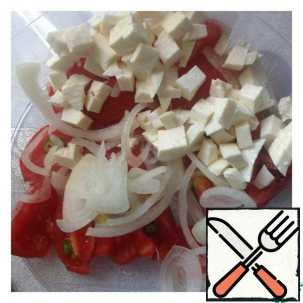 Onion cut into rings, Imereti cheese small cubes.
