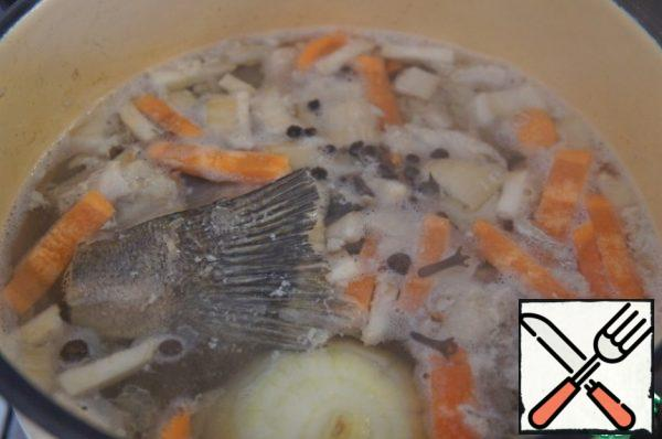 From fish waste, if they are, cook the broth with the addition of carrots, celery root, onions (all in addition, not from the recipe), black pepper and spices. I never throw away waste when cooking fish dishes (fins, bones, tail), store in the freezer until the case.