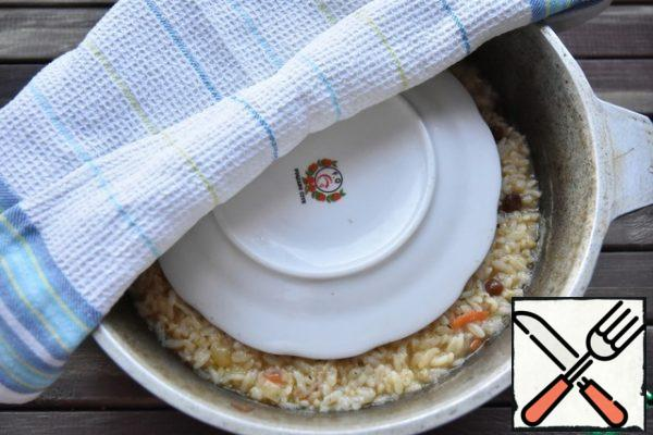 Simmer the pilaf on a minimum heat for 20 minutes. Then remove from heat and allow time to rest.