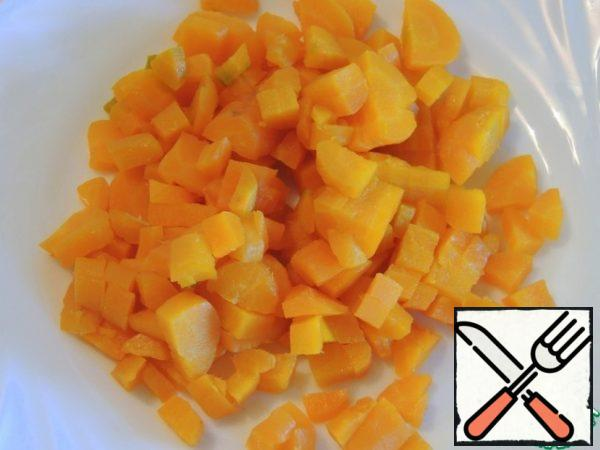 Boil the carrots and cut them into cubes.