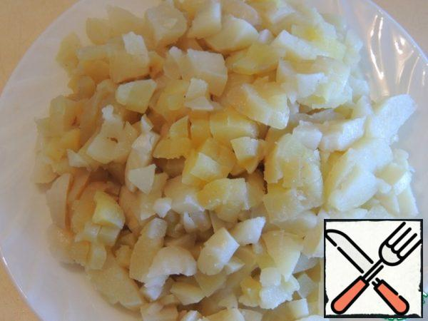 Boil the potatoes and cut them into cubes.