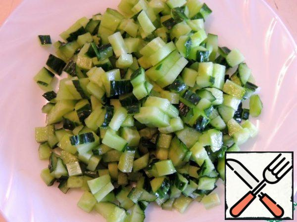 Cucumber is also diced.