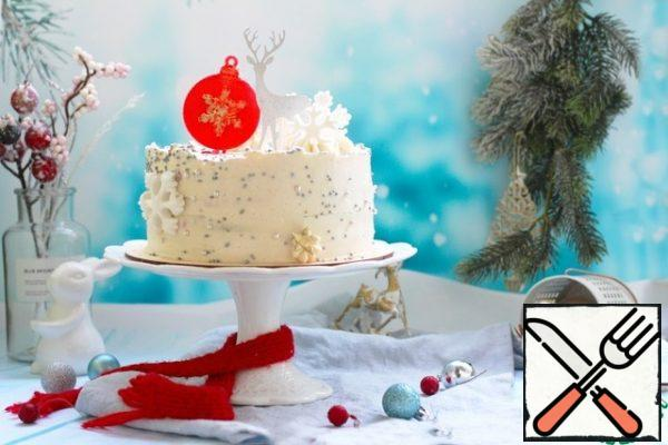 Take out the cake in the morning. Coat the sides and top with cream, align with spatula. Decorate on your own. I sprinkled sugar balls, cut out mastic snowflakes. In the center, I made a caramel ball in a silicone mold. Deer-ready topper.