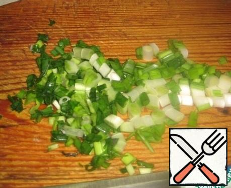 Finely chop the green onions.