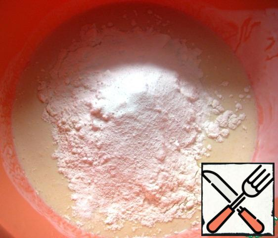 Pour the melted and cooled butter, mix. Add flour and baking powder.