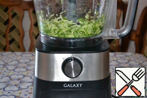 Grate fresh cucumber on a large grater. With this task for a couple of seconds coped food processor.
