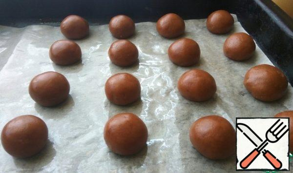 Roll 20 balls from the dough. Place the dough balls on a parchment-lined baking sheet.