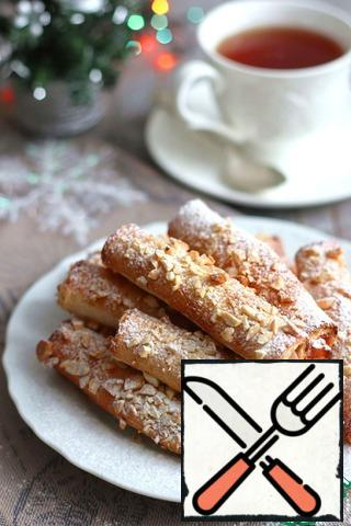 Ready-made tubes sprinkle with powdered sugar and you can invite guests.Enjoy your tea!
