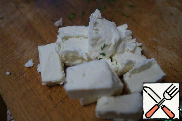 Cut the feta into cubes.