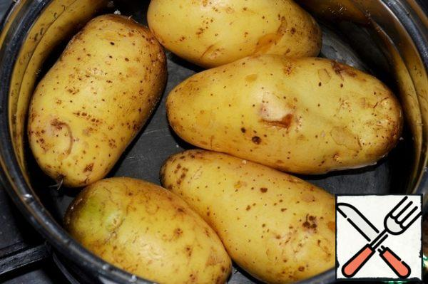 Wash the potatoes and boil in the skin until tender. Eggs also cook until tender and cool.