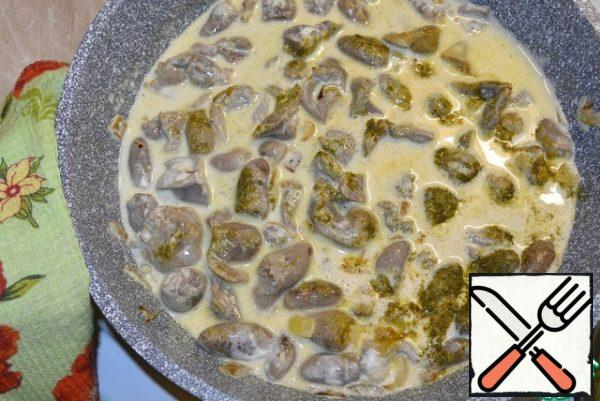 Add water, sour cream and hops. Simmer until the offal is ready.
