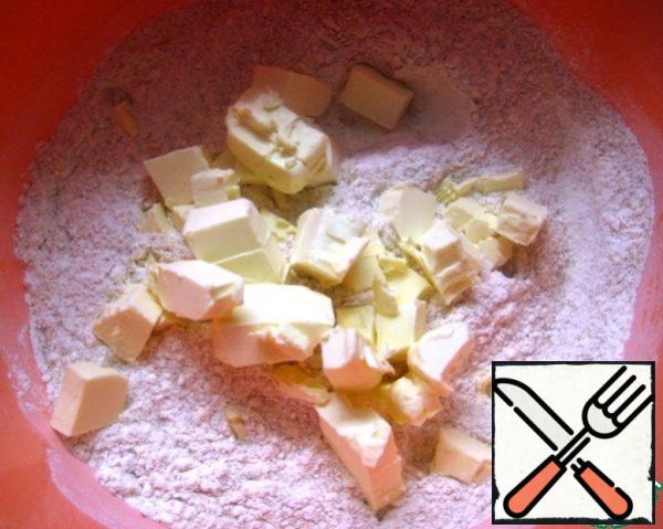 Add slices of cold butter.