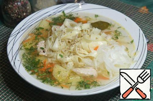 In a wide soup plate, pour the soup, put a good portion of noodles in the center of the plate, and place a handful of pickled onions on the side.