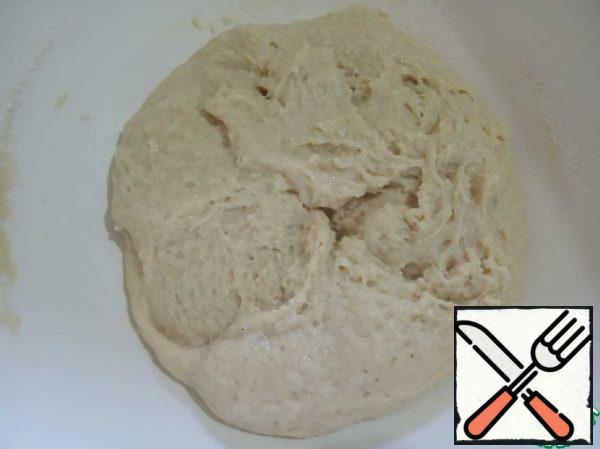 Add butter with sugar, baking powder, a pinch of salt, flour and mix thoroughly until smooth.