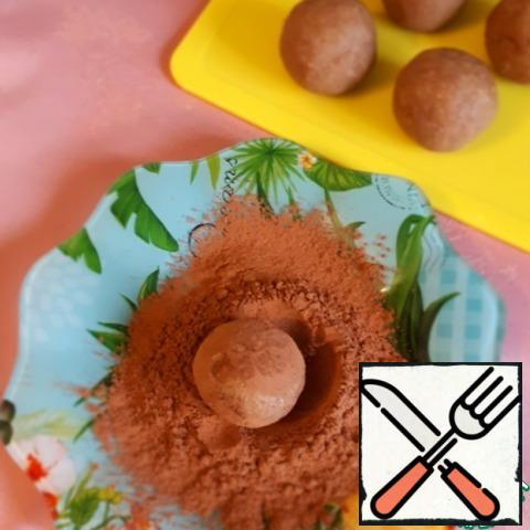 Roll the balls in cocoa powder.
