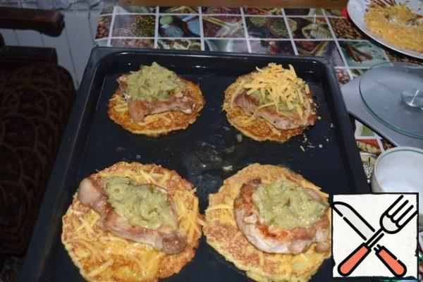 Put the meat on the pancakes. Put cucumbers with mustard on the meat. All sprinkle with the remaining cheese and send in the oven for 15-20 minutes.