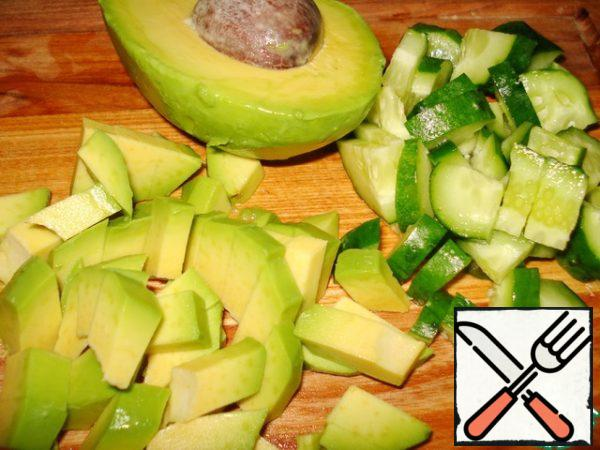 Cucumber cut into cubes. Peel the avocado and also cut into cubes.
