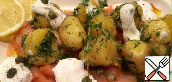 Drizzle with olive oil. Add the sour cream and horseradish sauce... I add some mint leaves and a tablespoon of capers.