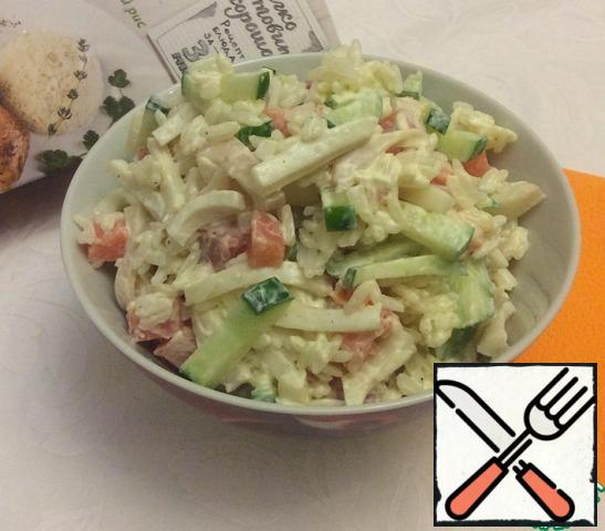 Clean the squid and boil it in salted water for 2 minutes. Remove from water and cool. Cut the squid into strips and put it in a salad bowl with the rest of the ingredients. Add mayonnaise to taste and mix thoroughly. If desired, add a little salt.