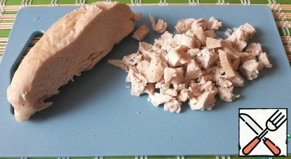 Boil the chicken breast. Cut into cubes.