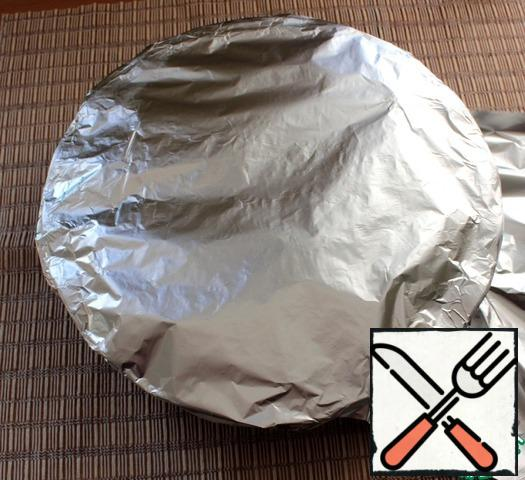 Cover the form with a lid or foil. Bake at a temperature of 180* until ready, I baked 1H 20 min. Focus on the nature of your oven. If you want to get a Golden crust, at the end of baking, remove the foil and bring to readiness.