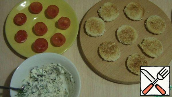 From the loaf, cut out mugs using a mold or shot glass. Dry on a dry pan until blush. Add the finely chopped dill and Basil, salt and pepper to taste and mix. With cherry tomatoes, you need to cut the bottom and clean out the flesh. Stuff tomatoes with prepared cheese.