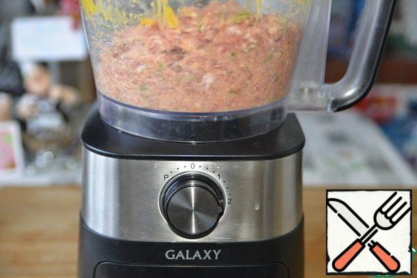 Grind the mass into minced meat. I used chopping knives in a food processor.