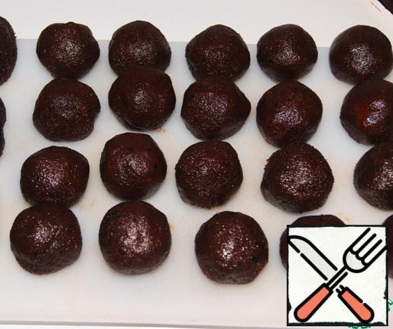 From the mass of about 25 g, make tortillas, place inside the prunes stuffed with nuts and roll into a tight ball. Place the balls in the refrigerator for a couple of hours and cool well.
