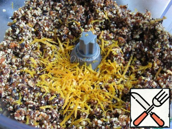 Grind for another 15-20 seconds until smooth. Add the orange zest and mix.