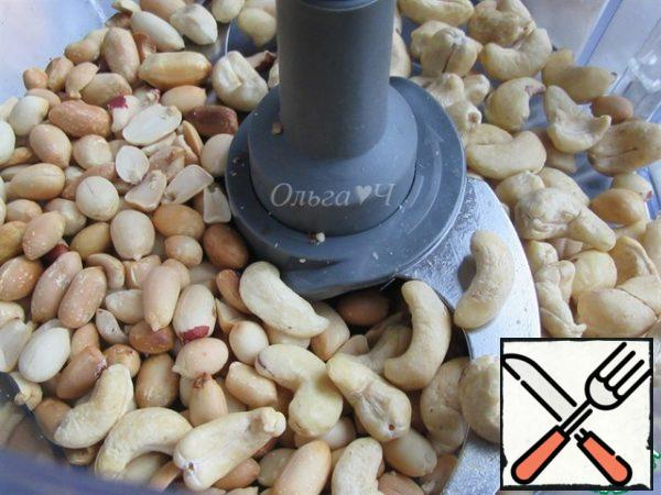 For the filling, place the cashews and peanuts in the bowl of the combine.