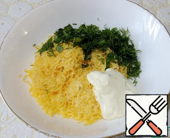 In another bowl, grate hard cheese, add mayonnaise, cut any greens, I took a sprig -dill, parsley, coriander, mix.
