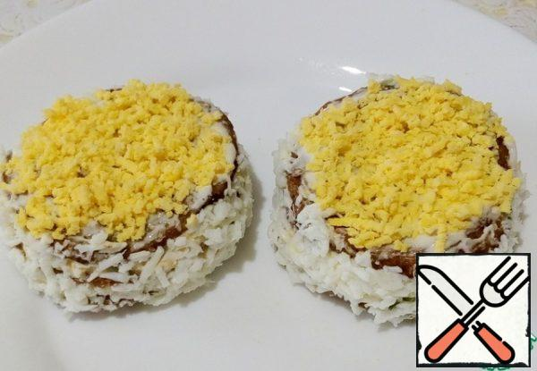 The top of the pancakes, just cover with mayonnaise and decorate with yolks.