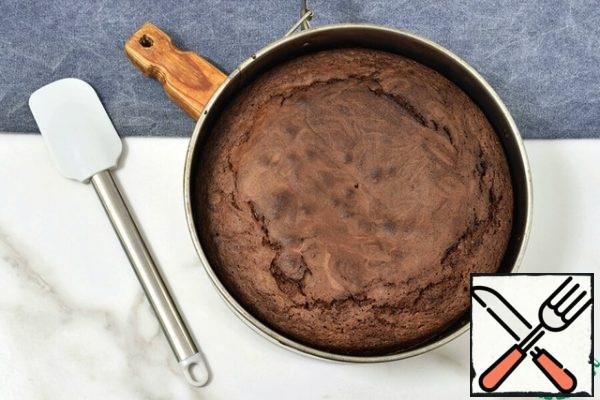 Check the readiness of the dough with a thin stick - it should come out with a small amount of wet crumbs. Don't over-dry the brownies.