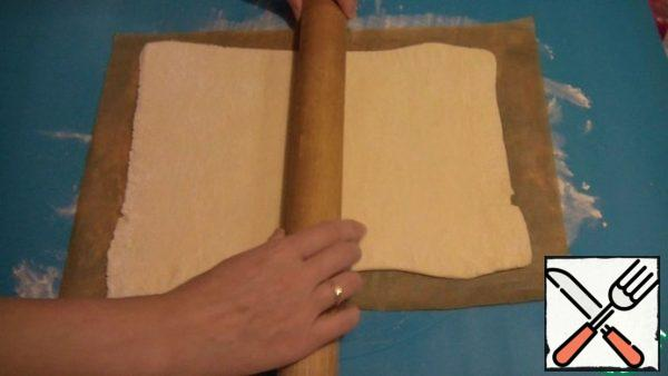 One layer of dough is rolled out into a rectangle, about 3-5 mm thick.