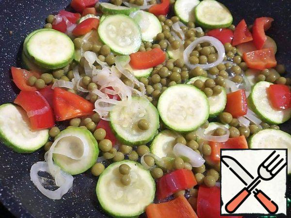 Add the green peas to the pan and mix gently.