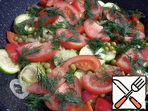 Add tomatoes and herbs. Salt and pepper to taste and heat for a minute, stirring gently.
