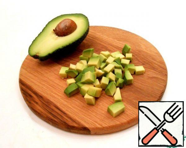 Peel and dice the avocado.