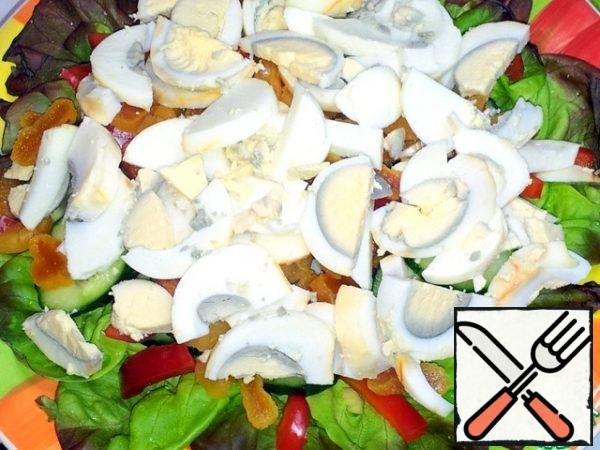 Cut the boiled eggs.
