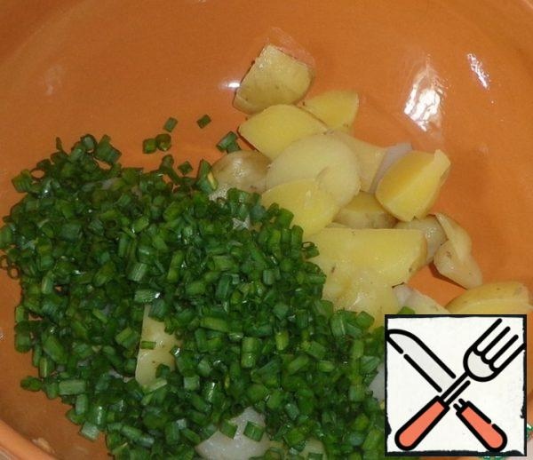Add the chopped green onion to the potatoes.