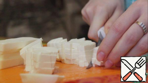 Add the feta cheese cut into small cubes .