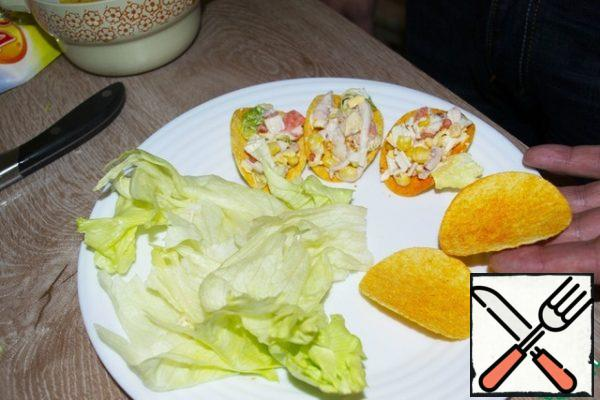Put the resulting salad in chips and decorate with simulated salmon caviar. Bon Appetit!
