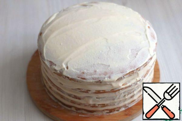 Spread the prepared cream over the cakes , the top and sides of the cake, then sprinkle with crushed crumbs. Decorate the cake to taste. As a decoration in this recipe, ready-made chocolate glaze was used.