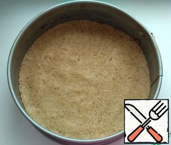 Mix the waffles and nuts, add the melted butter, and mix well. Split form (diameter 20 cm) lay parchment and distribute the waffle base. Put it in the refrigerator.
