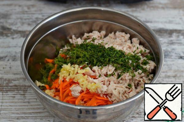 In a Cup or salad bowl, put the carrots, the remaining 50 grams of cheese, and finely chopped boiled chicken fillet. Add walnuts, chopped dill and garlic. Fill the filling with mayonnaise ( sour cream, yogurt), mix. Instead of chicken fillet, you can use any other meat component (ham, sausage, boiled beef or pork). Or you can not add poultry-meat at all . It also turns out delicious.