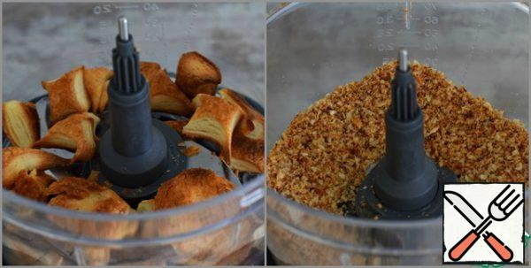 The cooled off scraps of dough that were baked together with the blanks for cakes, put in a bowl of food combine and chop into crumbs.