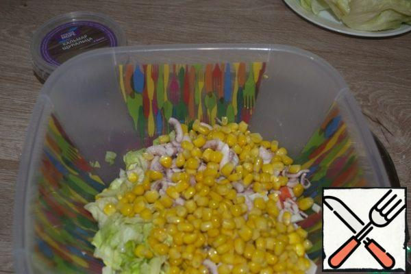 Drain the water from the jar, add the corn to the rest of the ingredients, and mix.