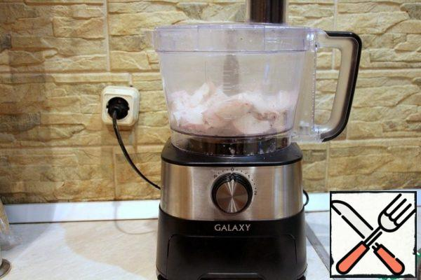 Boil the breast and chop it in a combine using a chopper knife.