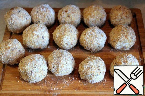 Form round croquettes and alternately roll in flour, egg, and breadcrumbs.