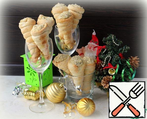 Puff cones fill with ready-made pate and serve to the table.